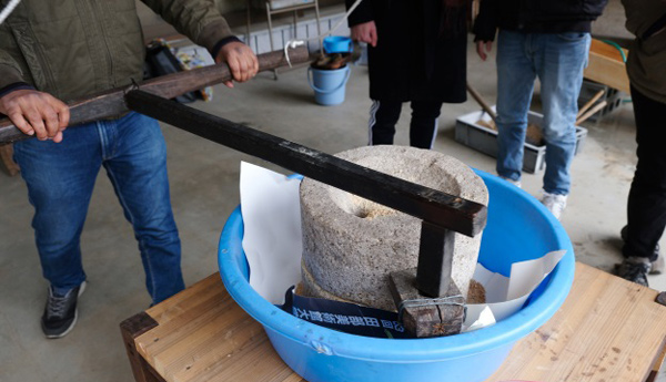 Traditional Mortar Stone-Crushed Soy Flour Activity